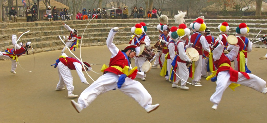 Pungmul is a Korean folk music tradition that includes drumming, dancing, and singing. Most performances are outside, with tens of players, all in constant motion. (Wikimedia Commons)