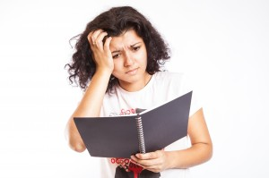 An image of college student vexed by her loan schedule (Flickr, by CollegeDegrees360)