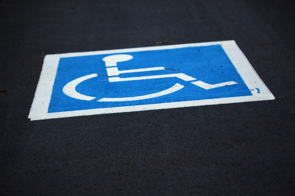 citizens that find illegally parked cars can report the car simply scanning the QR code on the disabled parking space signs, which will automatically record the place and time of the violation. (image credit: by pinksherbet at flickr)