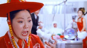 "Scene from ""Wedding Palace"" - Comedian Bobby Lee & American actress Angela Oh share moment of domestic bliss. (image: GoGoGo Entertainment /PRweb)"
