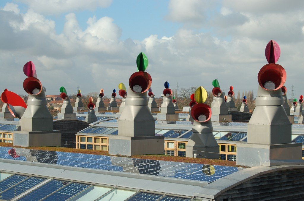 BedZED (Beddington Zero Energy Development), the UK's largest and first carbon-neutral eco-community: the distinctive roofscape with solar panels and passive ventilation chimneys (Wikipedia)