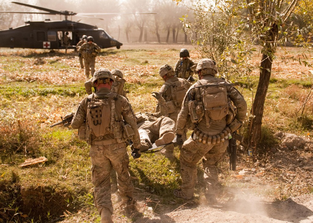"""These children are struggling with the particular challenges of not  only of being part of a military family, but readjusting to a 'new  normal' when a parent comes home with a life-altering injury,"" said Dr.  Mary Jo Schumann. (image: Evacuating a wounded soldier by Fort Bragg/Flickr)"