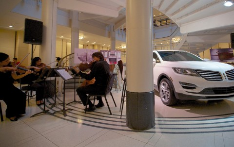 2015 Lincoln MKC, the brand's first small premium utility, provides compelling starting point for informative, entertaining dialogue at Chicago Symphony Orchestra. (image credit: Lincoln Motor Company)