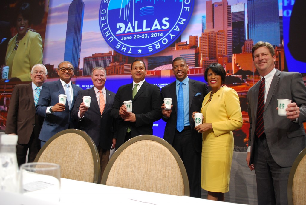 Starbucks and the U.S. Conference of Mayors (USCM) launch Solutions CitySM at the 82nd Annual Meeting of the USCM in Dallas. Through this one-of-a-kind initiative, mayors and citizens in five cities will meet at their local Starbucks stores to identify and tackle civic challenges. From left to right, Tom Cochran, CEO of USCM, Columbus Mayor Michael Coleman, Orlando Mayor Buddy Dyer, Starbucks chief community officer Blair Taylor, USCM President Sacramento Mayor Kevin Johnson, Baltimore Mayor Stephanie Rawlings-Blake, and Phoenix Mayor Greg Stanton (image: Starbucks)