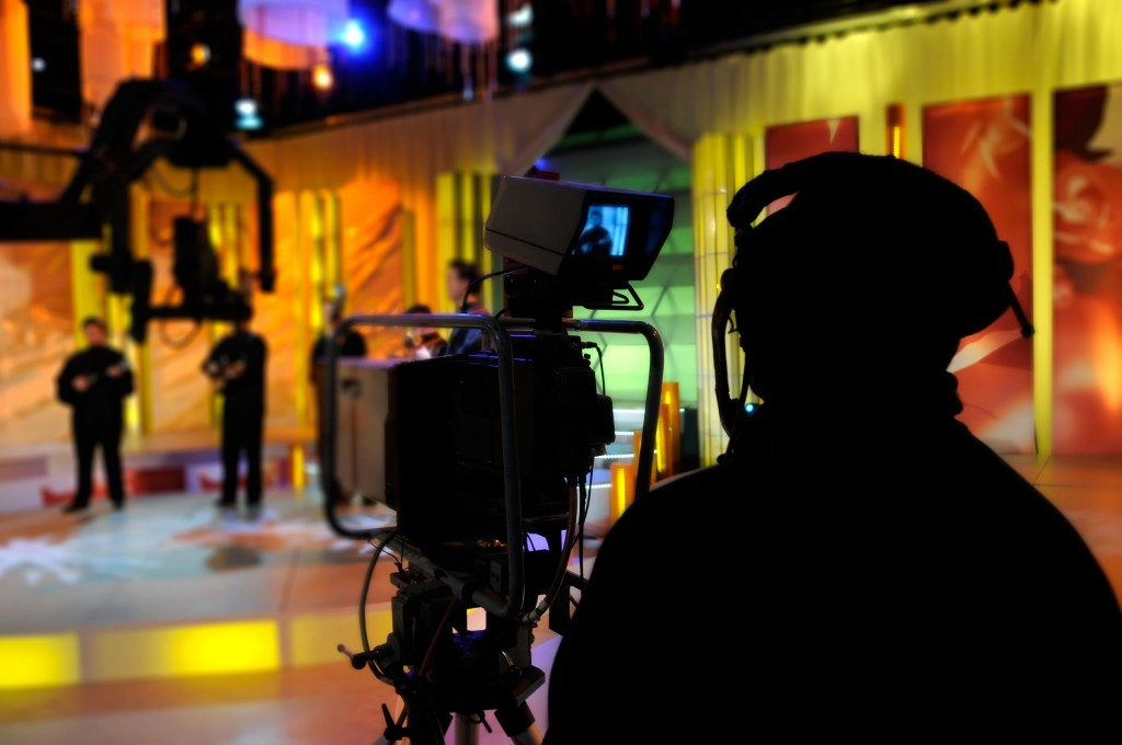 Event will feature experts involved in the filming, telecasting, broadcasting of 2014 FIFA World Cup in the highest clarity to beyond TV screens (image: Cameraman works in the studio - recording show in TV studio, courtesy of Kobizmedia/ Korea Bizwire)