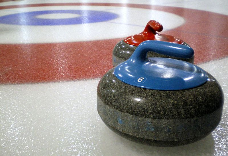 "A great deal of strategy and teamwork go into choosing the ideal path and placement of a stone for each situation, and the skills of the curlers determine how close to the desired result the stone will achieve. This gives curling its nickname of ""chess on ice"". (image: Curling stones on rink with visible pebble by Wikimedia Commons)"