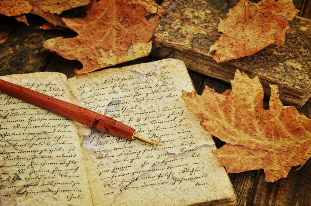 Fountain pen on old handwritten book with autumn leaves (courtesy of Kobizmedia/ Korea Bizwire)