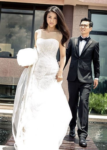 Chinese Superstar Tang Wei and Korean Director Kim Tae-yong Go to U.S. for Honeymoon