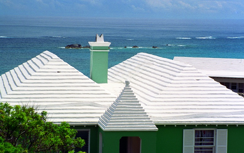 """Cool roofs can be well displayed in Bermuda Style.""  The archetypical Bermuda house is a low, squared building with a stepped, white roof and pastel-painted walls, both of which are made out of stone. (image: Wikipedia)"
