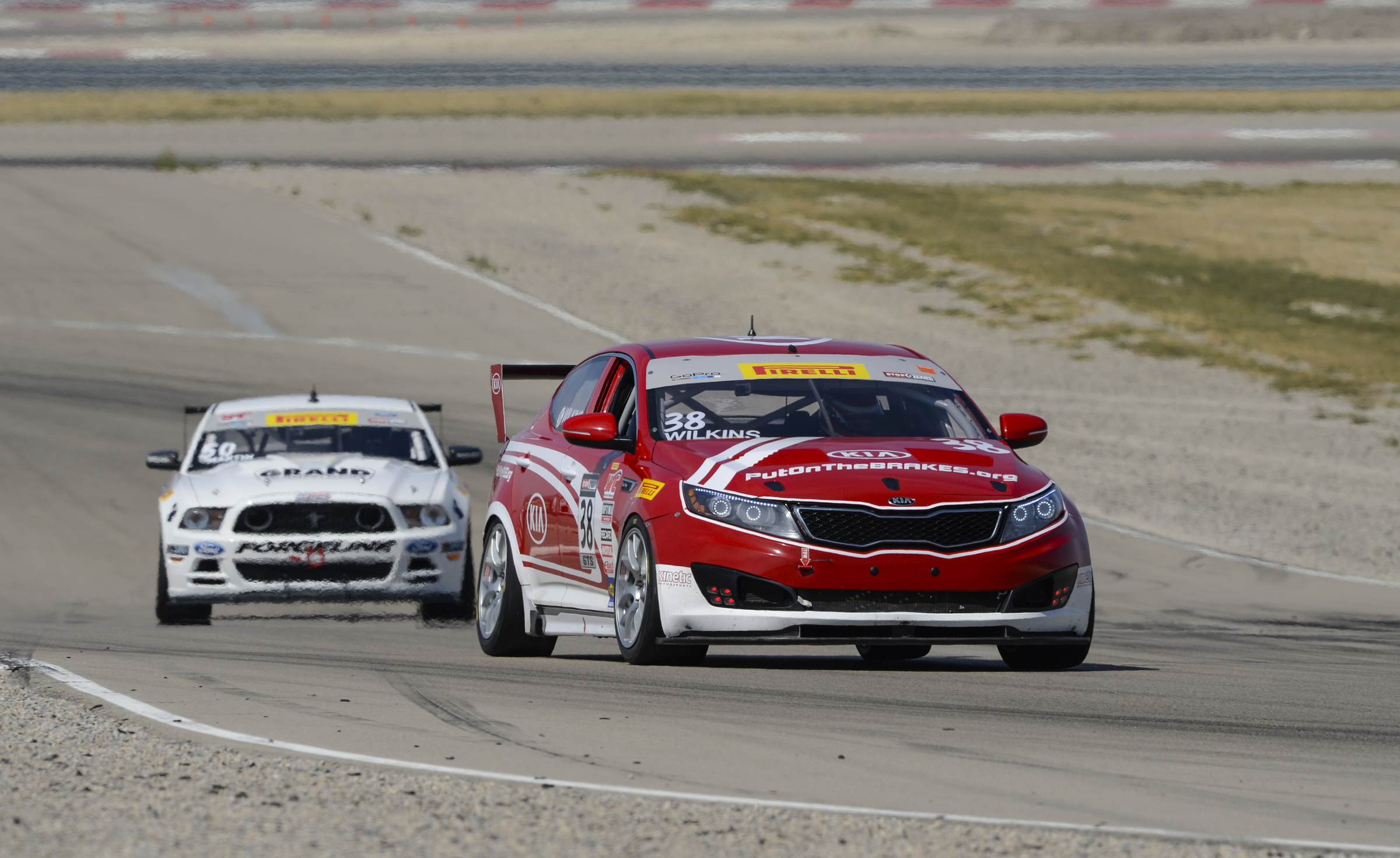 Kia Motors claimed the 2014 Pirelli World Challenge Grand Touring Sport and Touring Car A Manufacturer Championships at the series' season finale this past weekend at Miller Motorsports Park in Tooele, Utah. (image credit: Kia Motors America)