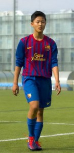 Lee Seung-woo in FC Barcelona uniform