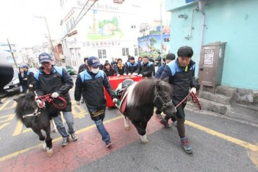 KRA Busan Employees Deliver Briquettes with Ponies