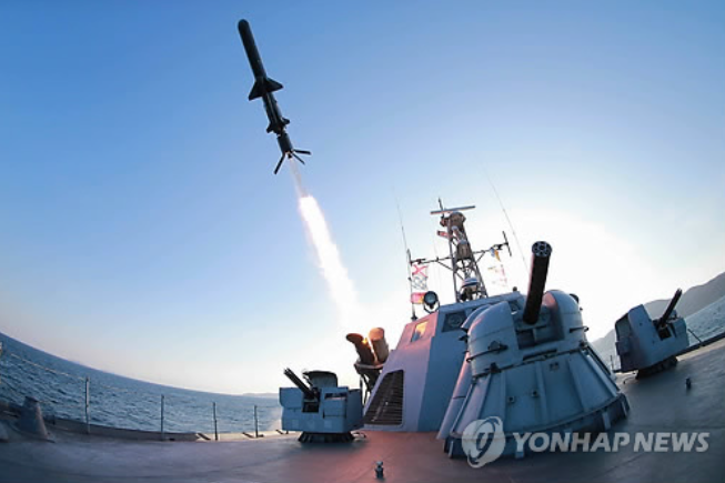 """The ultra-precision anti-ship rocket blasted off from a rocket boat. The intelligent rocket precisely sought, tracked and hit the 'enemy' ship after taking a safe flight,"""" announced North Korea's KCNA. (Photo courtesy of Yonhap)"""