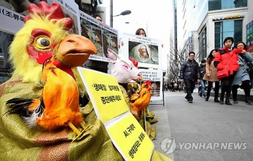 Animal-Masked Activists Campaign for Lower Meat Consumption amidst Mass Culls