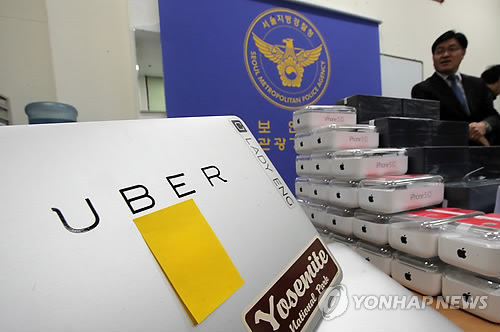 According to police, 27 are suspected of connecting passengers with nearby drivers through the UberTaxi app without a license. (image: Yonhap)