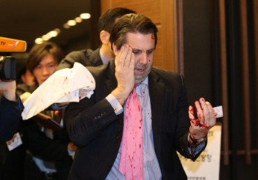 Two Koreas Exchange Accusations over Knife Attack on U.S. Envoy