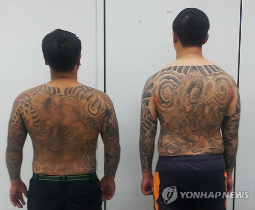 Police Fines Two Gangsters for Displaying Their Tattoos