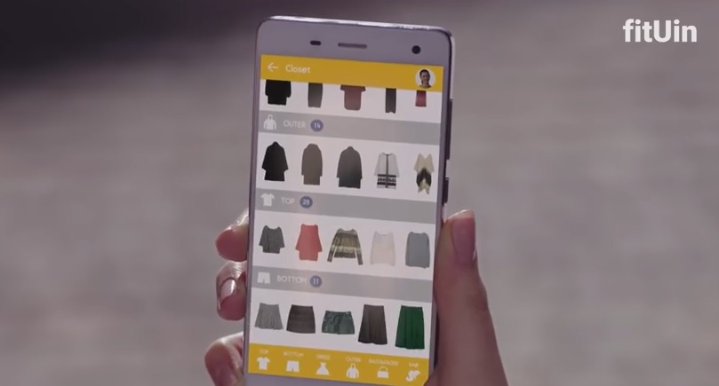 The app enables users to try on a variety of fashion items, and helps with styling.  (image: Youtube capture from fitUin TV advertisement)