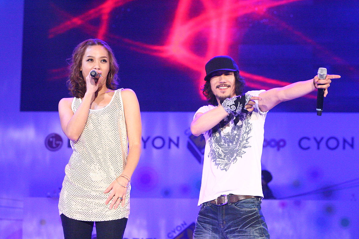 """Pay Day,"" featuring Yoon Mi-rae(L)'s  husband and hip-hop artist Tiger JK(R), is a track from Yoon's third studio album released in 2007. (image: wikipedia)"