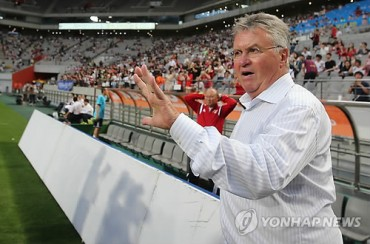 Football Coach Hiddink Preaches Tough Love for Young Prospects