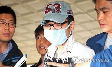 Police Request Arrest Warrant for Sewol Activist on Burning National Flag
