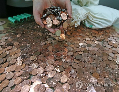 Shameful Employer Pays Back Wages with 10 Won Coins
