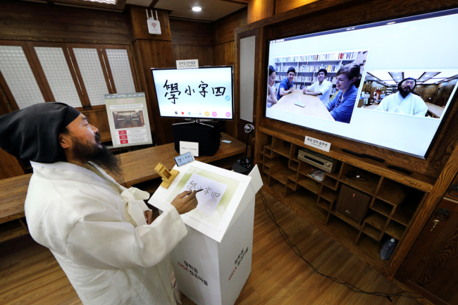 KT transformed the village's small two-story library into a smart library with cutting-edge gadgets and solutions, such as electronic boards that transfer writing to anyone who's connected to a network. (image: KT)
