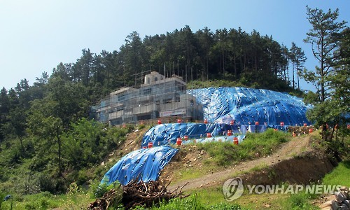There are worries about reckless development. Soil erosion on the hills nearby the construction site is drawing concern. (Image : Yonhap)