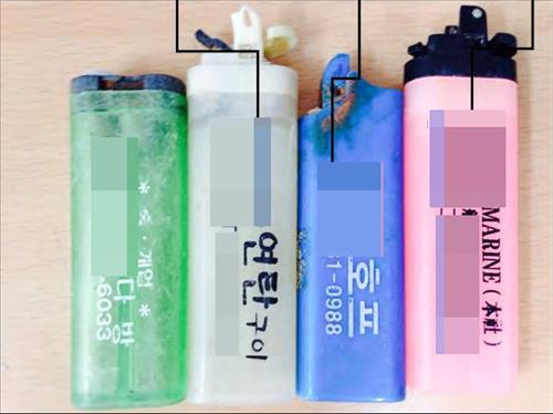 The research team estimated the origins of the trash based on phone numbers and business names printed on some of the lighters.  (Image : Yonhap)