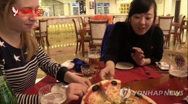 Photographer's Video of N.Korean Pizzeria Going Viral