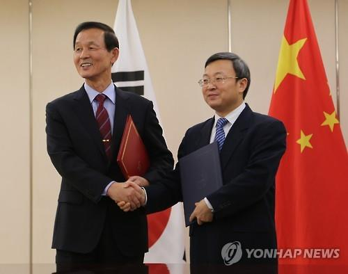 A free trade agreement between South Korea and China will come into force on Dec. 20, officials said Wednesday, about six months after the two nations formally signed the deal aimed at slashing tariffs and other trade barriers. (Image : Yonhap)