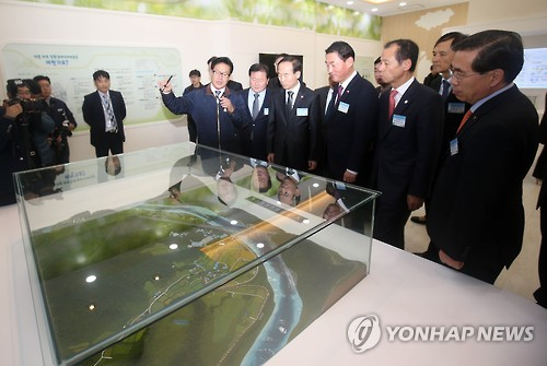 A ribbon cutting ceremony was held to celebrate the completion of Hongcheon Eco-friendly Energy Town, which is composed of unwanted public facilities such as manure treatment plants. (Image : Yonhap)