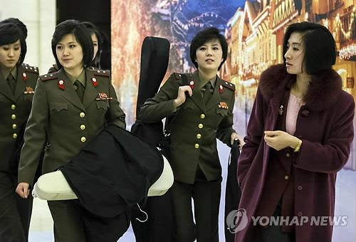 The Moranbong Band was scheduled to perform for three days in Beijing from Saturday, in an apparent sign of warming relations between the two countries. (Image courtesy of Yonhap)