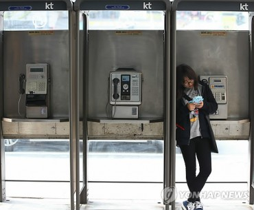 Goodbye Faded Memories: Phone Booths Disappear