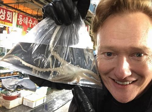 "comment ""Went to the fish market today and bought a pet octopus. I named him Samuel. #ConanKorea #southkorea #travel."" (Image : Yonhap)"