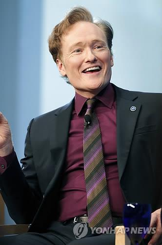 In this AP file photo released on May 24, 2012, Conan O'Brien discusses his life and the art of comedy during a forum at the John F. Kennedy Presidential Library in Boston. (Image : Yonhap)