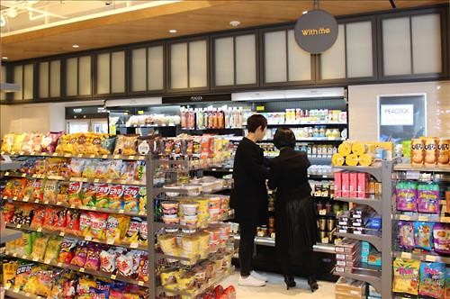 With Me, the convenience store managed by Shinsegae group, announced that they opened a new store in the SUM Market located in the Samsung-dong building of SM Entertainment. (Image : SM Entertainment)