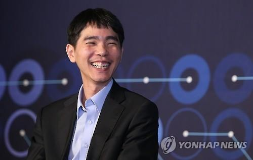 South Korean Go player Lee Se-dol smiles after defeating Google's artificial intelligence program AlphaGo in their fourth Go match held at the Four Seasons Hotel in Seoul on March 13, 2016. (Image : Yonhap)