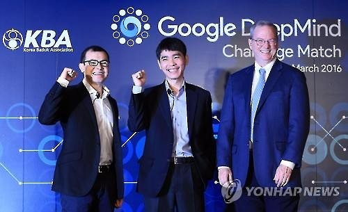 From left: Demis Hassabis, the CEO of Google DeepMind, South Korean Go player Lee Se-dol and Google Chairman Eric Schmidt pose for a photo at a press conference at the Four Seasons Hotel in Seoul on March 8, 2016, a day before Lee plays a Go match against Google's Artificial Intelligence program AlphaGo. (Image : Yonhap)