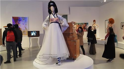 A new iteration of traditional Korean costume by Jean Paul Gaultier is displayed at Dongdaemun Design Plaza in central Seoul on March 25, 2016. (Image : Yonhap)