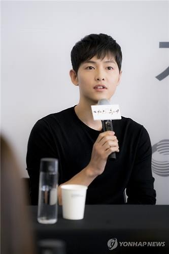 Actor Song Joong-ki speaks to reporters at Hyundai Motorstudio in Seoul on March 16, 2016. (Image : Yonhap)