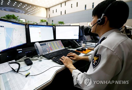 On Friday, April Fool's Day, police officers and firefighters working in dispatch centers around the country started their day worrying about the prank calls they would have to deal with all day. (Image : Yonhap)
