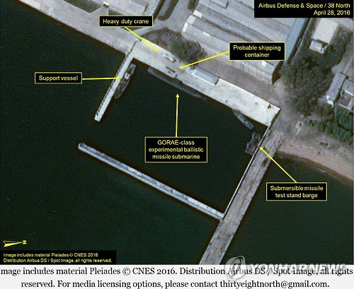 This image taken of the North`s Shinpo Shipyard on April 29, 2016, six days after the North`s latest submarine-launched ballistic missile (SLBM) test, shows that a submersible missile test stand barge has been moved from its normal position, in this photo provided by the website 38 North and Airbus Defense and Space. (image: Yonhap)