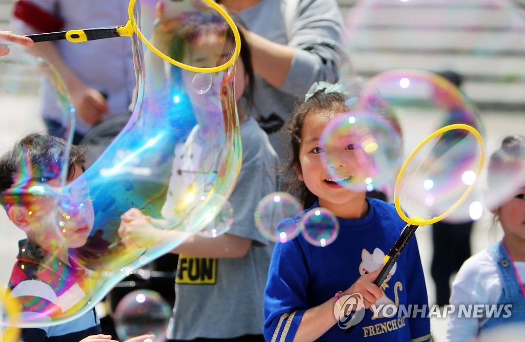 Children play with soap bubbles at Daejeon Expo Park.