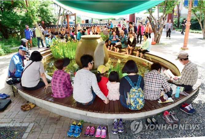 Visitors experience 'herbal foot bath'.