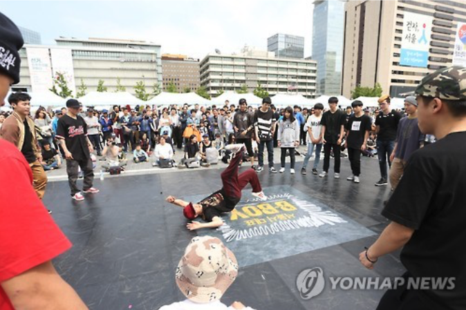 B-boy group performing on Sejong Street, Seoul.