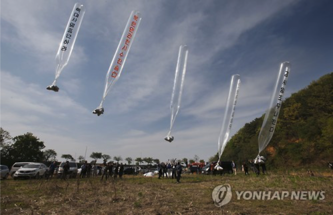 South Korean organizations launch large balloons containing propaganda leaflets on April 29, 2016.