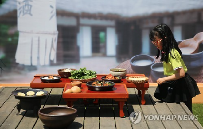 A child experiences Korean traditional tavern.