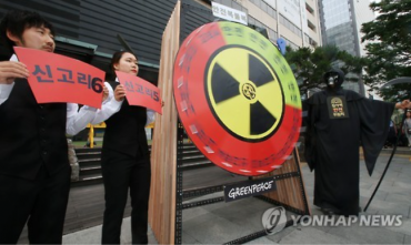 Black Hood with Scythe Appears at Anti-nuclear Protest