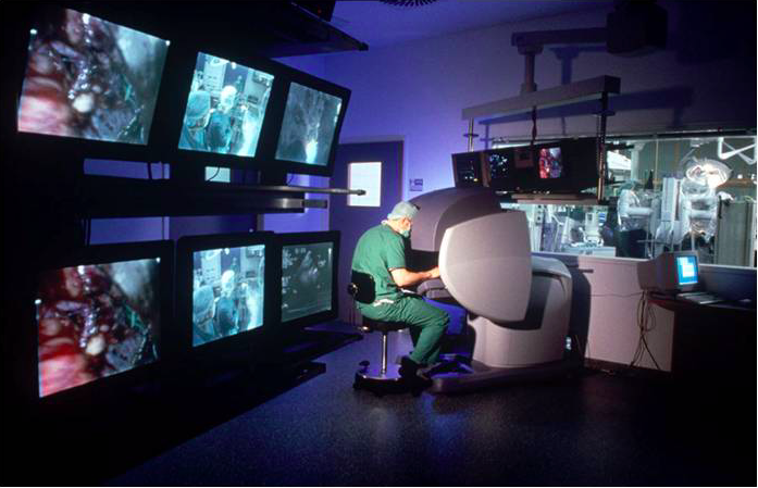 """Perhaps if specialists from the fields of medicine, mechanical engineering, and computer engineering all work together, artificially intelligent robot-assisted surgery will be a reality in our future,"" said Catherine Mohr, the vice president of medical research at Intuitive Surgical. (Image Courtesy of Wikipedia)"